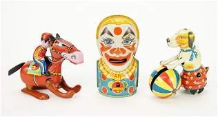 Three Lithograph Tin Toys.
