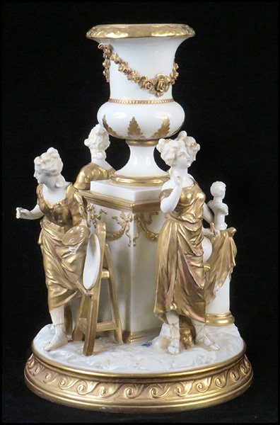 A German Gilt Porcelain Figural Group.