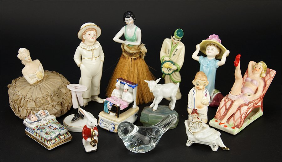 A Collection of Porcelain Figures and Boxes.