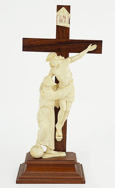 A Mahogany and Carved Ivory Crucifix.