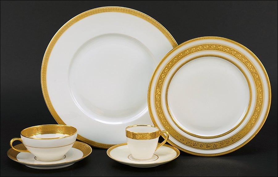 An Assembled Gilt Porcelain Dinner Service.