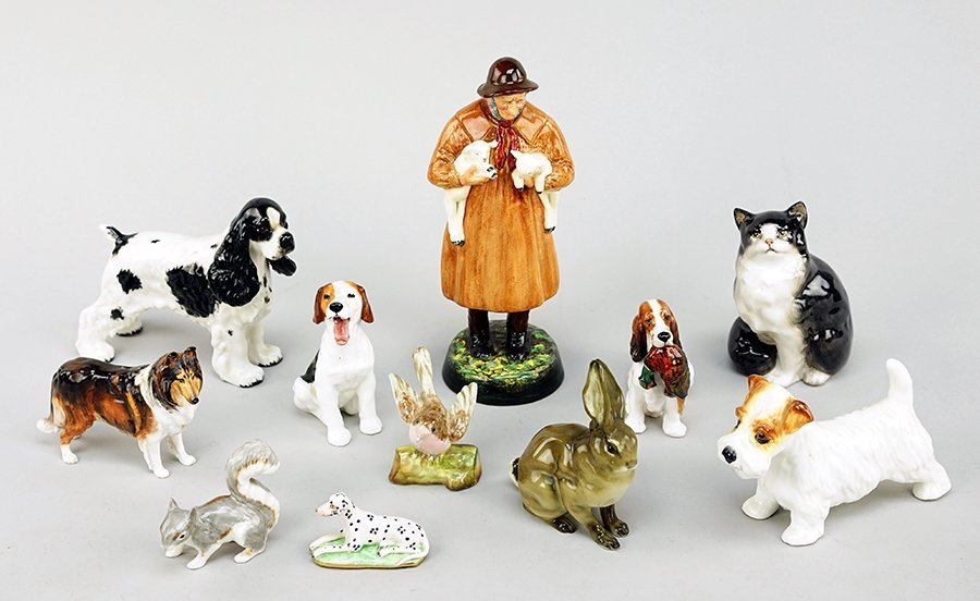 Three Royal Doulton Porcelain Dogs.