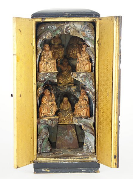 A Chinese Lacquered Wood Traveling Shrine.
