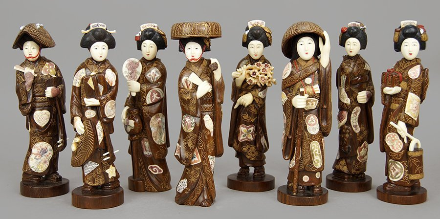 A Set of Eight Chinese Polychrome Decorated Wood and