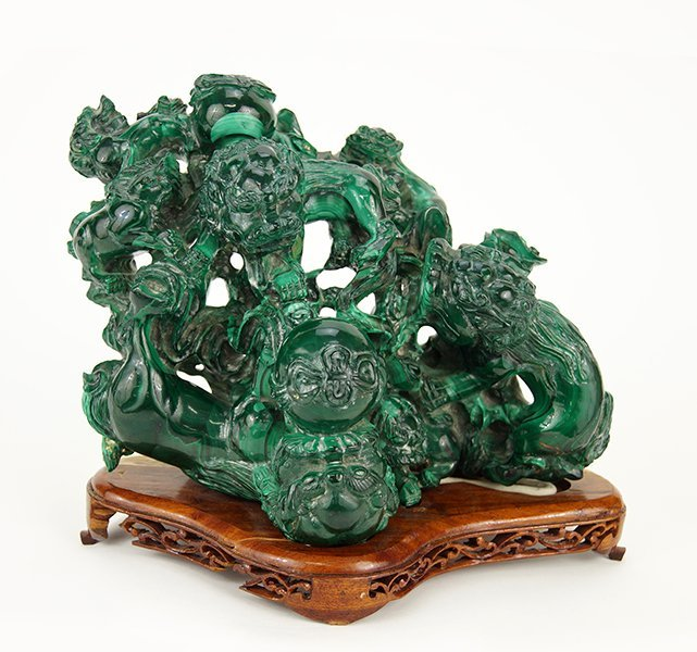 A Chinese Carved Malachite Figural Group.