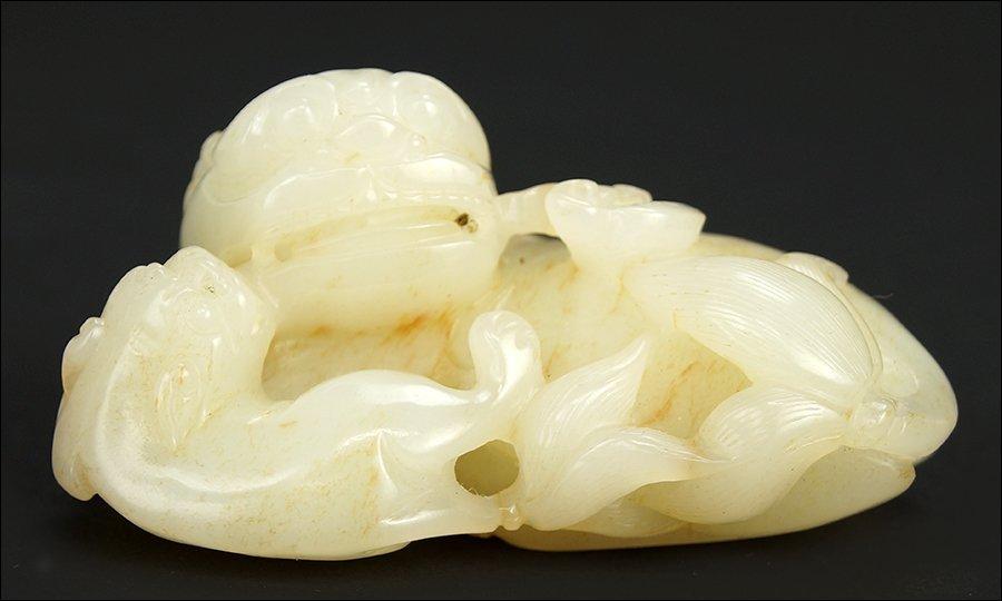 A Carved Jade Figural Group.