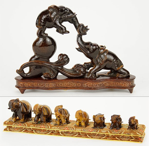 A Carved Tiger's Eye Figural Group.