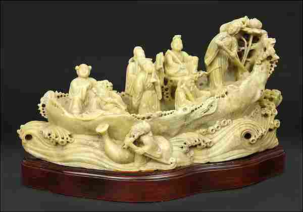 A Chinese Carved Soapstone Figural Group.