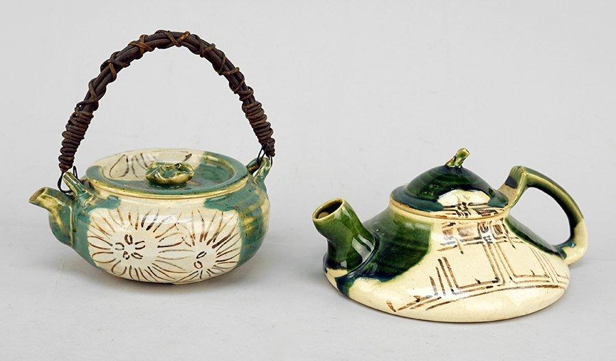 Two 20th Century Japanese Oribe Stoneware Teapots.