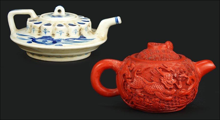 A Chinese Cinnabar Teapot.