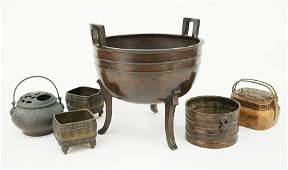 A Collection of Asian Patinated Metal Table Items.