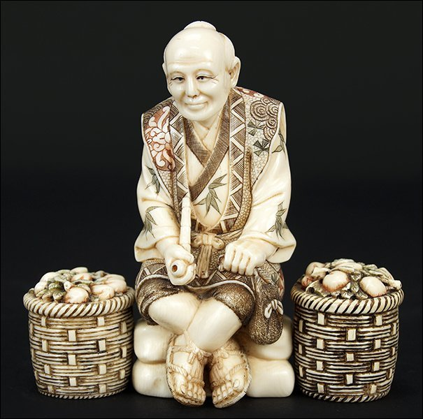 A Chinese Carved and Polychrome Decorated Ivory Figure.