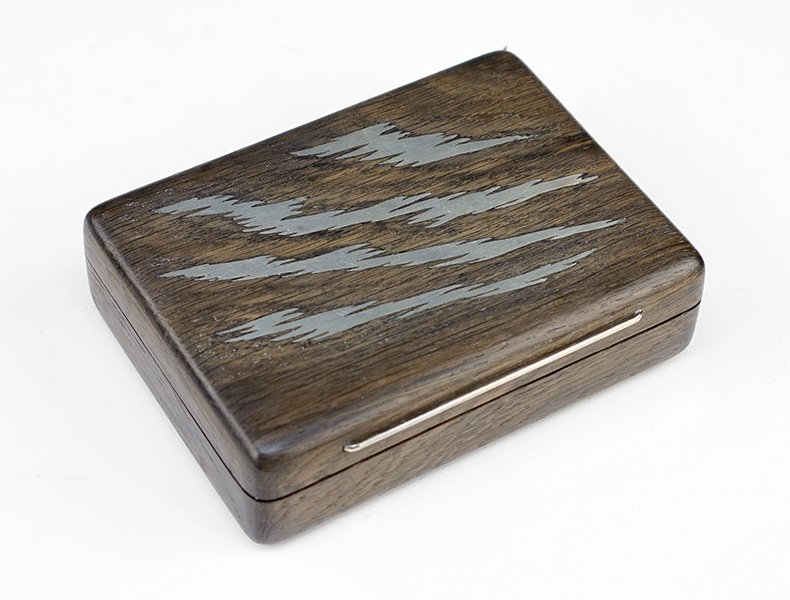 A Sterling Silver Inlaid Wood Box.