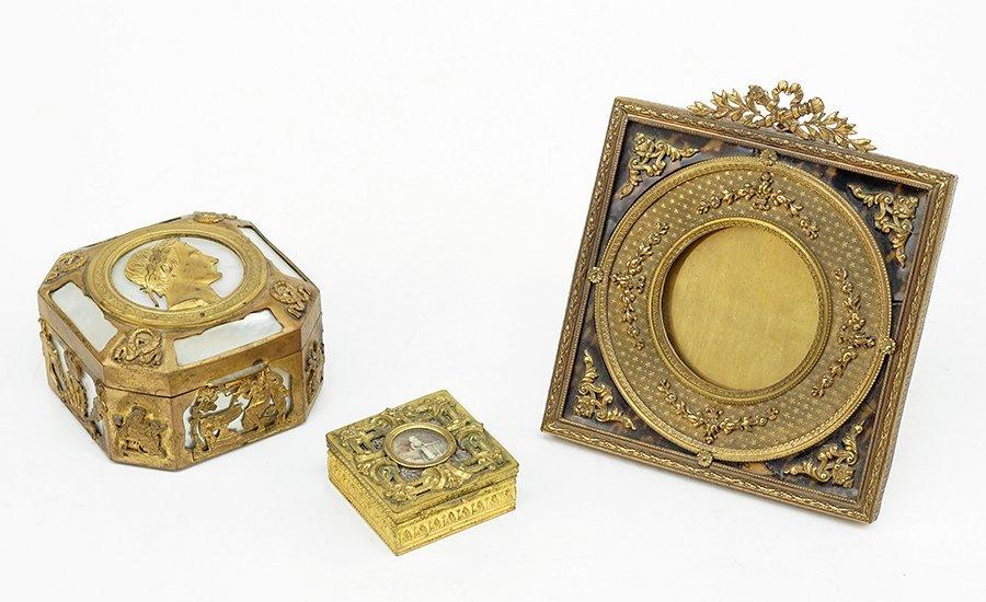 A Patinated Bronze Napoleon Box.