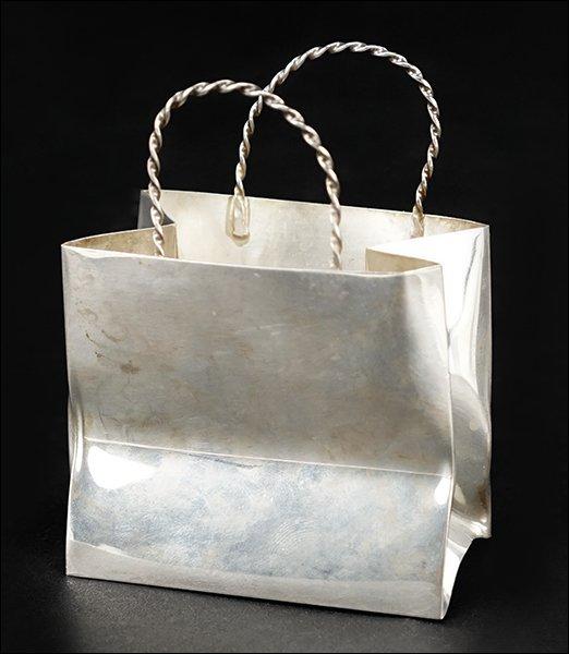 A Cartier Sterling Silver Basket.