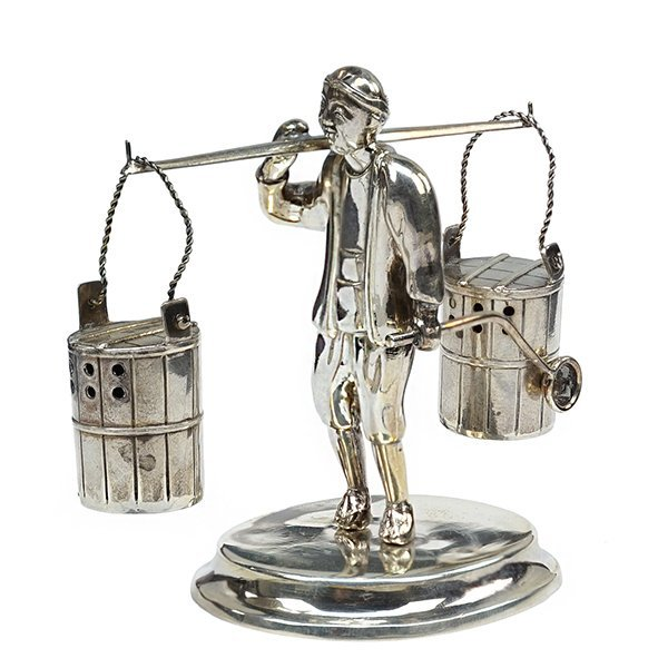 A Sterling SIlver Figural Salt and Pepper Suite.