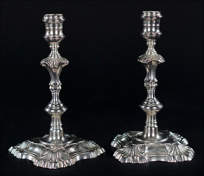 A Pair of George II Silver Candlesticks.