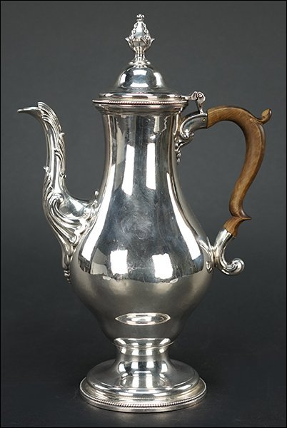 A George III Silver Coffee Pot.