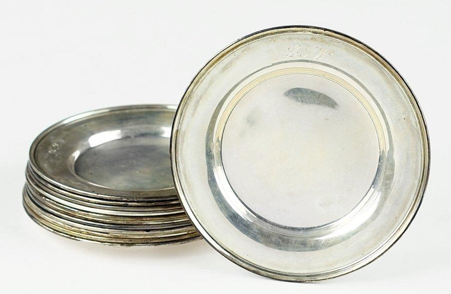 A Set of Twelve Monogramed Sterling Silver Plates.