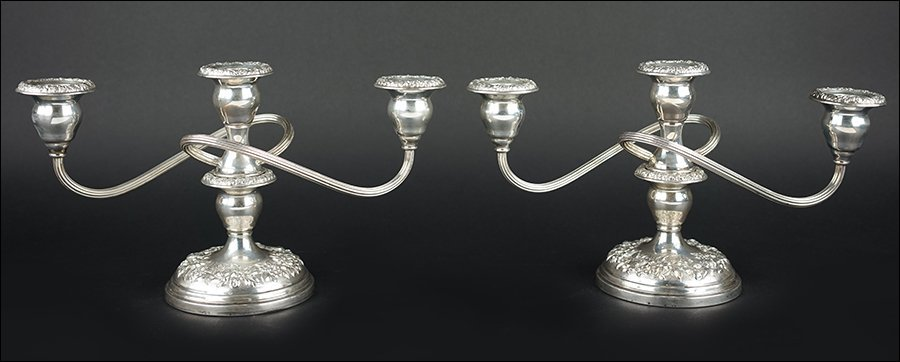 A Pair of American Sterling Silver Weighted Candelabra.