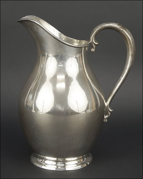 A Reed & Barton Sterling Silver Water Pitcher.