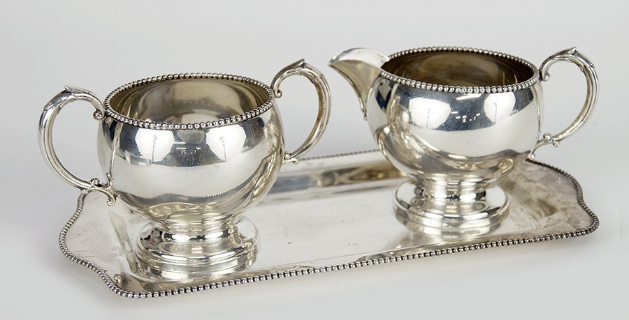 An American Sterling Silver Creamer and Sugar Bowl.