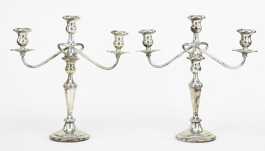 A Pair of Fisher Weighted Sterling Silver Candelabra.