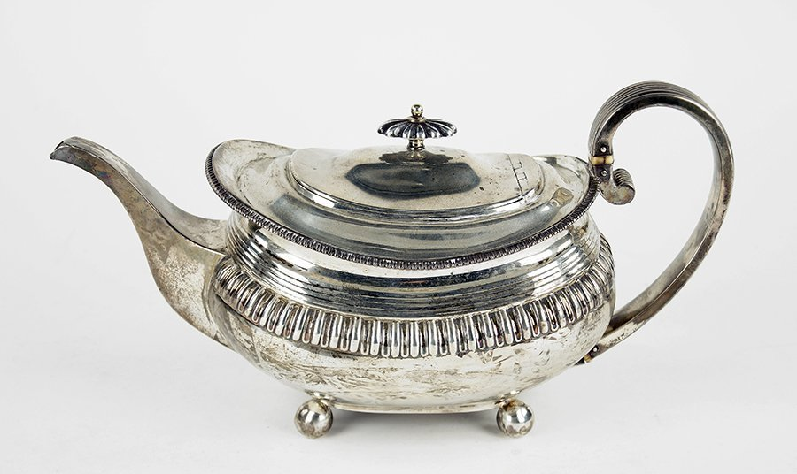 An English George IV Silver Teapot.
