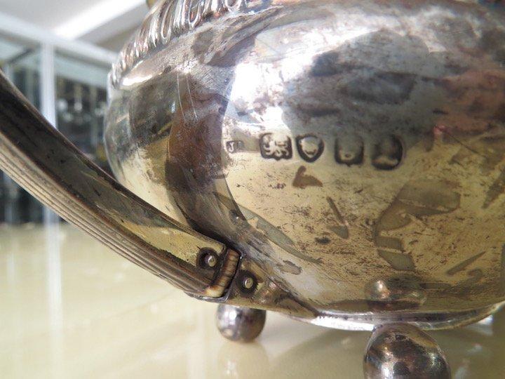 An English George IV Silver Teapot. - 2