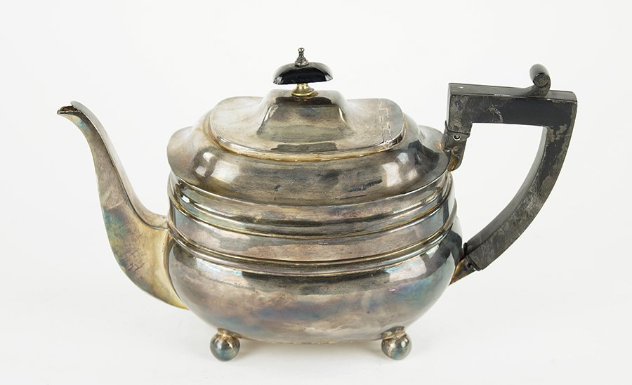 An English George III Silver Teapot.