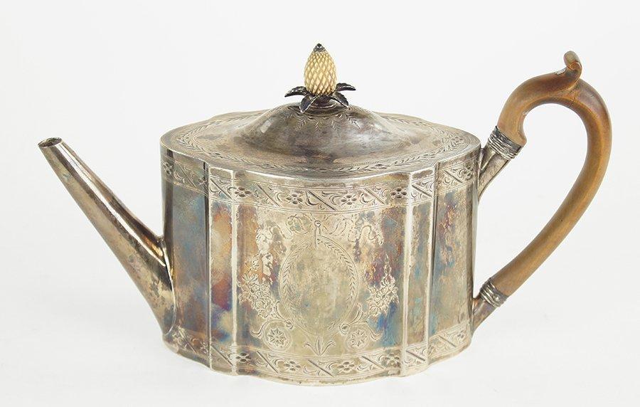 An English George III Silver Teapot.