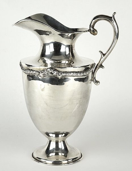 A Mexican Marmolejo Sterling Silver Pitcher.