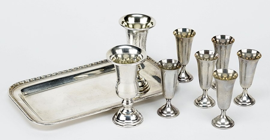 A Set of Six Sterling Silver Cordial Glasses.