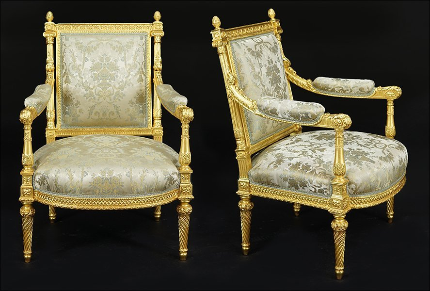 A Pair of French Gilt Wood Open Armchairs.