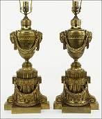 A Pair of Gilt Bronze Andirons.