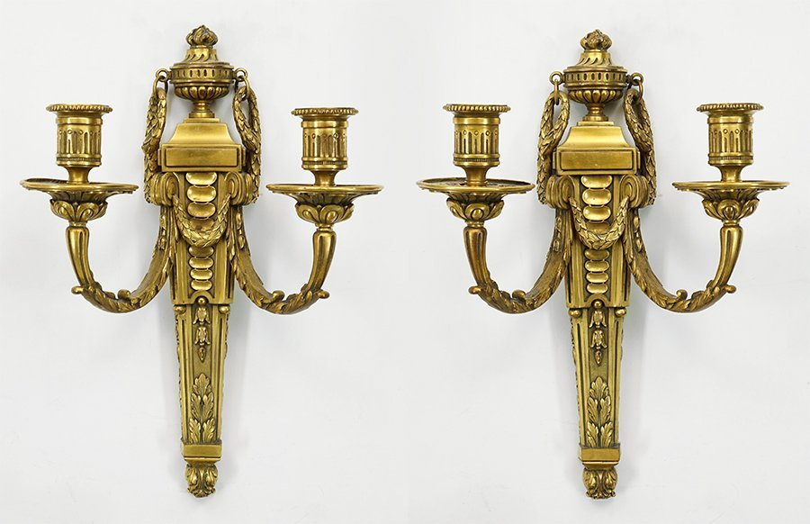 A Pair of French Gilt Bronze Two-Light Sconces.