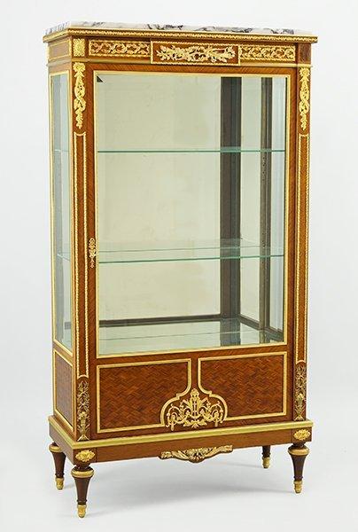 A Louis XVI Style Gilt Marble Top Vitrine.