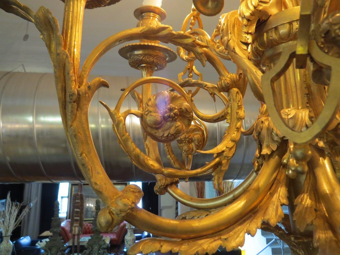 A French Gilt Metal Six-Light Chandelier. - 4