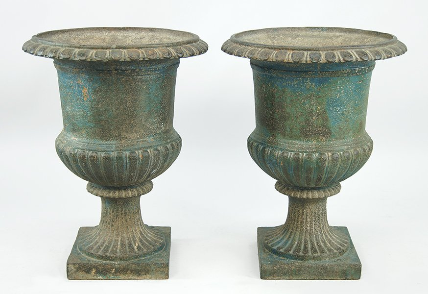 A Pair of Cast Iron Urn Form Planters.