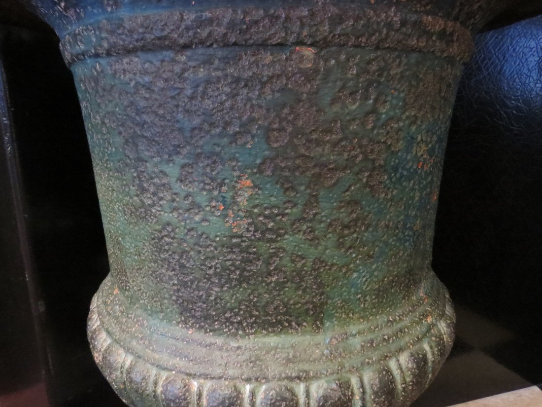 A Pair of Cast Iron Urn Form Planters. - 2