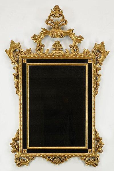 A Rococo Style Gold Mirror.