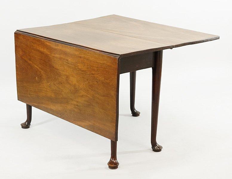 An English George II Mahogany Drop Leaf Table.