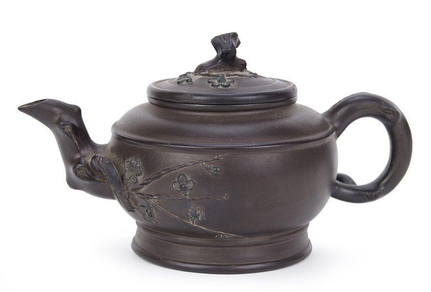 A Chinese Yixing Zisha Pottery Teapot.