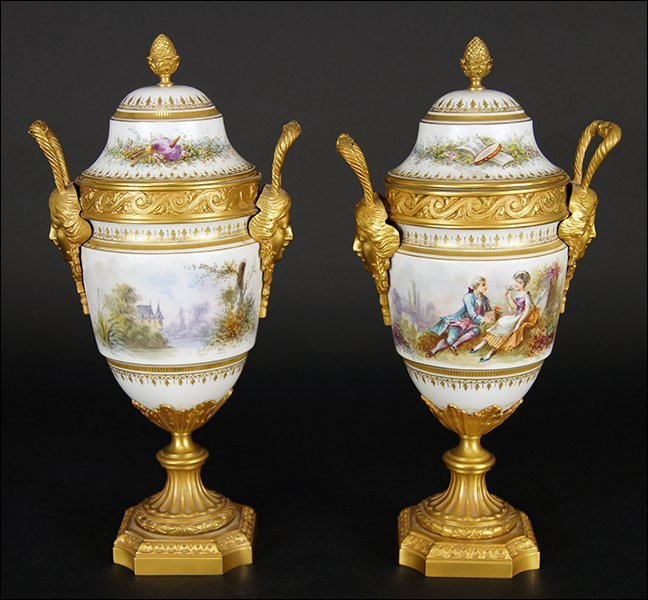 A Pair of French Porcelain Covered Urns.
