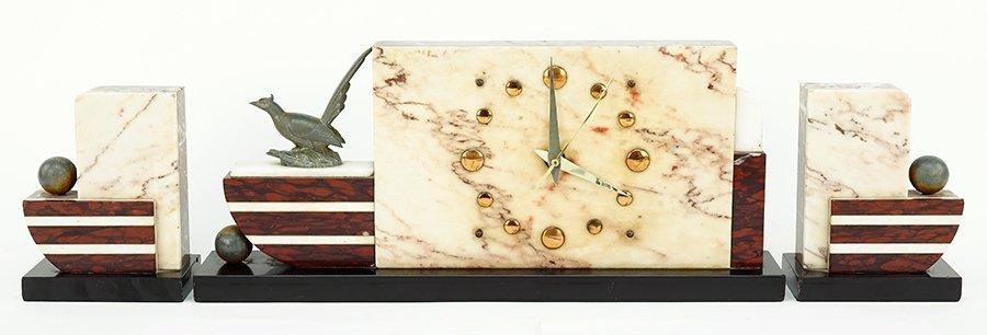 An Art Deco Clock and Garniture.