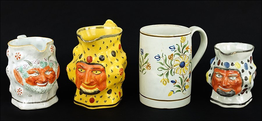 Three Staffordshire Pottery Face Jugs.