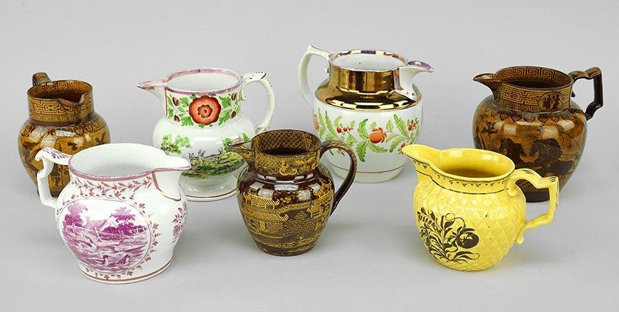 Four 19th Century Lusterware Jugs.