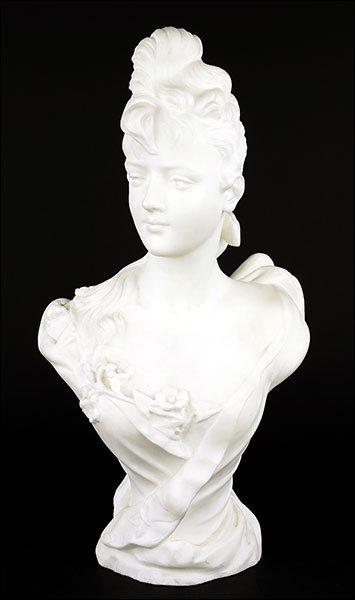 An Art Nouveau Carved Marble Bust.
