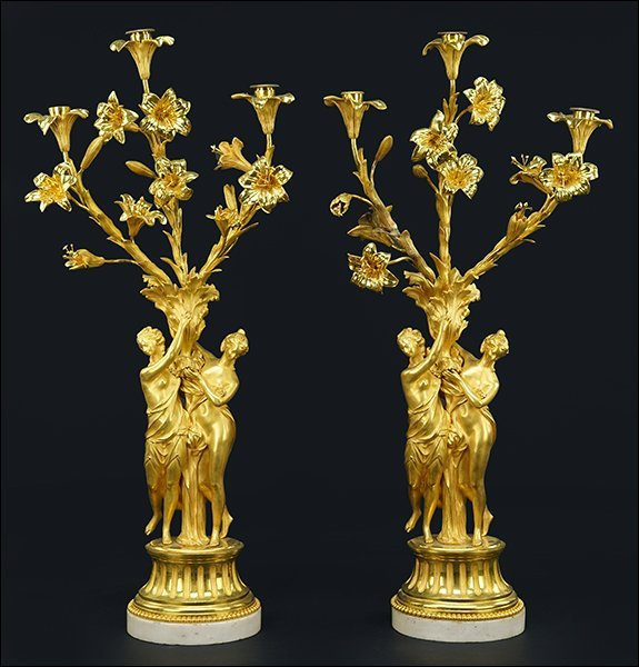 A Pair of French Gilt Metal Figural Three-Light
