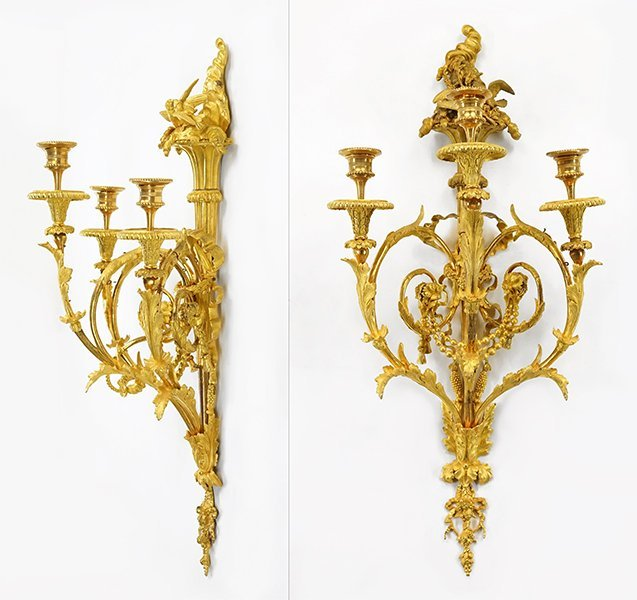 A Pair of French Gilt Metal Three-Light Wall Sconces.